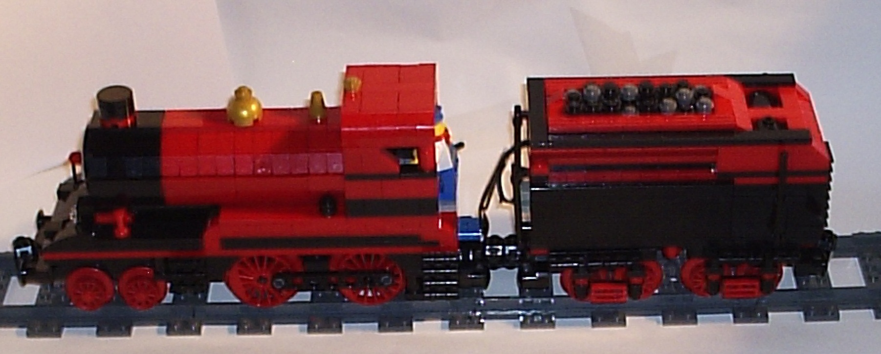 15_07_2012_red_and_black_4_4_0_tender_engine_f.jpg