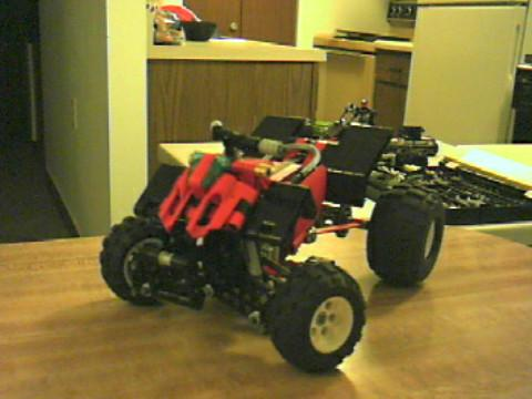 red_four_wheeler__atv_with_larger_wheels.jpg