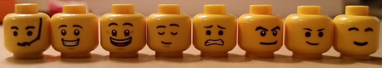 http://www.brickshelf.com/gallery/minifig77/stills/heads1.jpg