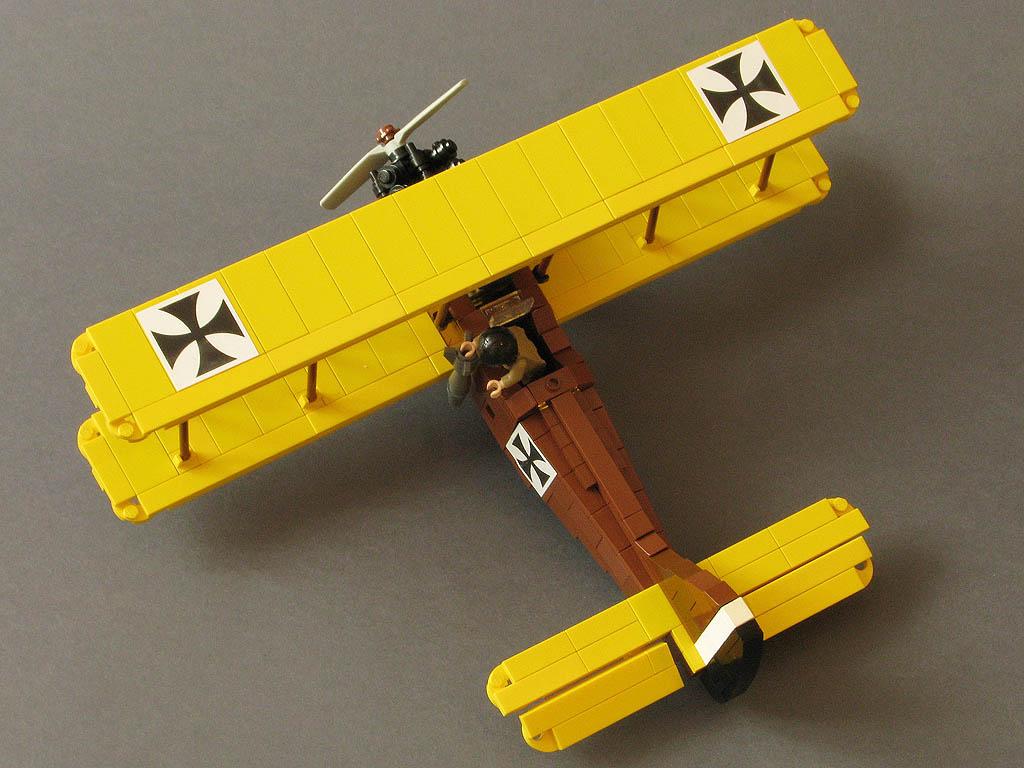 http://www.brickshelf.com/gallery/mrutek/00-Biplane-bomber/bomber_02.jpg