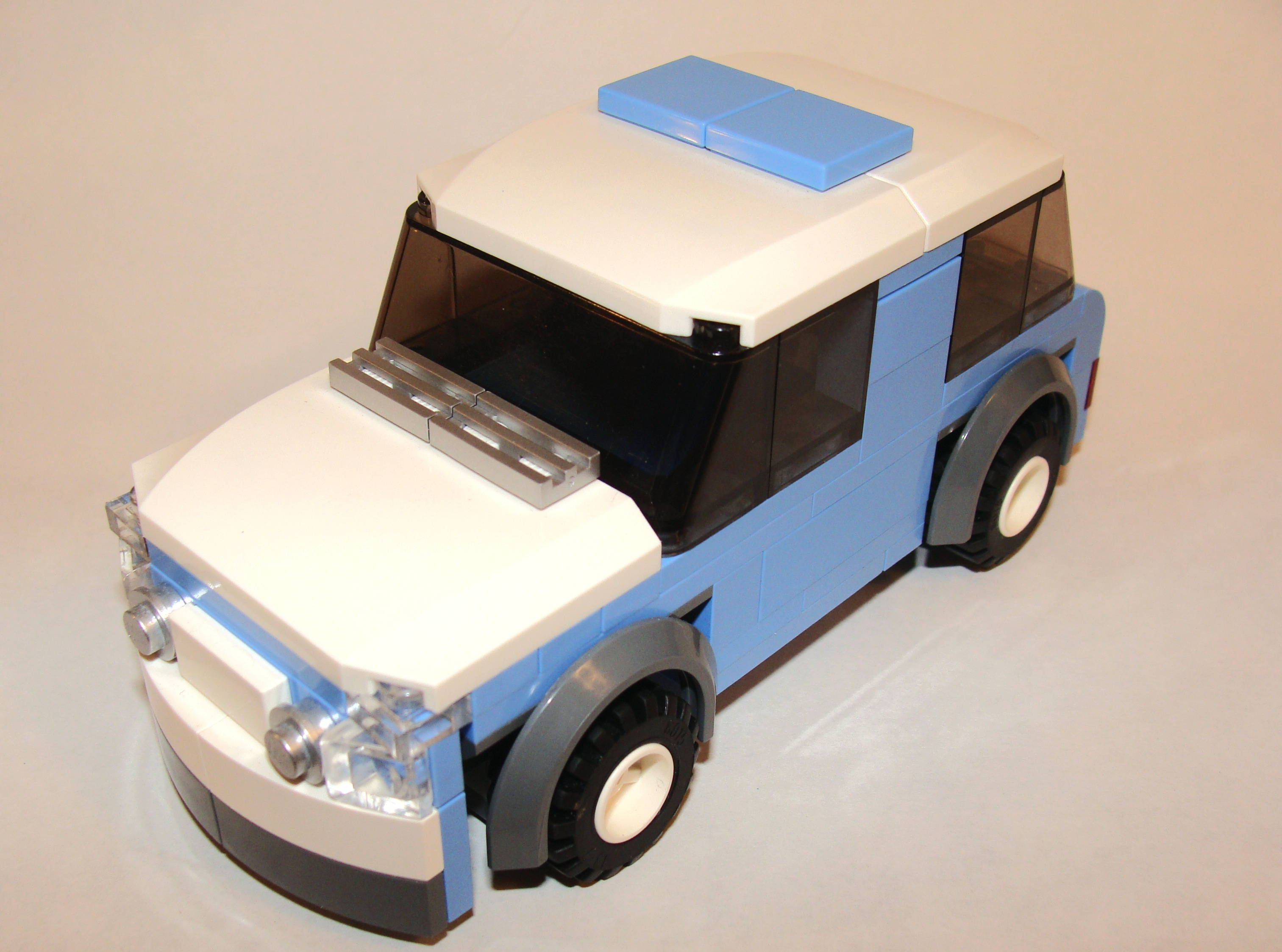 med_blue_car_6_wide_front_angled.jpg