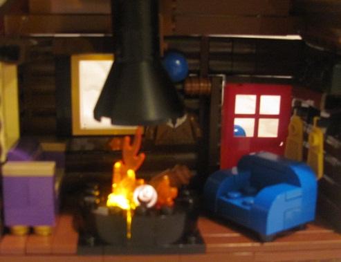 winter_cabin_lighted_fireplace.jpg